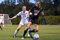 Texas forward Olivia Brook (29) attempts to turn around Texas State defender Savanah Warnick (19) during first half of an NCAA soccer game, Sunday, September 21, 2014 in San Marcos, Tex. Texas defeated Texas State 2-0. (Mo Khursheed/TFV Media via AP Images)