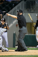 Home plate umpire Sean Barber makes a call on a check swing during the International League game between the Louisville Bats and the Charlotte Knights at BB&T BallPark on May 12, 2015 in Charlotte, North Carolina.  The Knights defeated the Bats 4-0.  (Brian Westerholt/Four Seam Images)