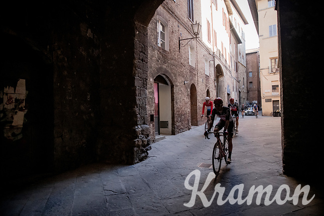 riders returning to the team buses post-race <br /> <br /> 15th Strade Bianche 2021<br /> ME (1.UWT)<br /> 1 day race from Siena to Siena (ITA/184km)<br /> <br /> ©kramon