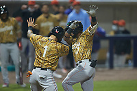 Keyber Rodriguez (17) of the Down East Wood Ducks celebrates with teammate Cody Freeman after hitting a 2-run home run against the Kannapolis Cannon Ballers at Atrium Health Ballpark on May 8, 2021 in Kannapolis, North Carolina. (Brian Westerholt/Four Seam Images)