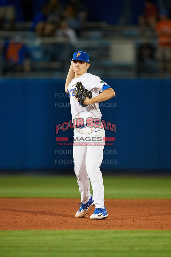 Florida Gators shortstop Brady McConnell (4) throws to first base during a game against the Siena Saints on February 16, 2018 at Alfred A. McKethan Stadium in Gainesville, Florida.  Florida defeated Siena 7-1.  (Mike Janes/Four Seam Images)