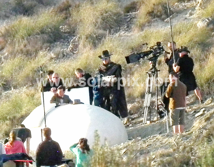 """**ALL ROUND EXCLUSIVE PICTURES FROM SOLARPIX.COM**.**WORLDWIDE SYNDICATION RIGHTS**                                                                               Caption:  Karen Gillan who plays Dr Who's played by Matt smith's companion Amy Pond on the set filming the new Doctor who series """"Gun slingers"""" in Spain. .Karen strolled around between takes on the Western film set playing ball games with a friend who looks very similar to Matt Smith..Karen has just split from her long term partner so could this be the beginning of a new romance.The series will include half robot & half human cowboys fighting with the doctor and his pretty assistant. . This pic:Robot & Matt Smith                                                                                         JOB REF: 14546       RAP       DATE: 09.03.2012                                                           **MUST CREDIT SOLARPIX.COM OR DOUBLE FEE WILL BE CHARGED**                                                                      **MUST AGREE FEE BEFORE ONLINE USAGE**                               **CALL US ON: +34 952 811 768 or LOW RATE FROM UK 0844 617 7637**"""