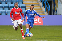 Dominic Samuel of Gillingham in action as Charlton's Chuks Aneke looks on during Gillingham vs Charlton Athletic, Sky Bet EFL League 1 Football at the MEMS Priestfield Stadium on 21st November 2020