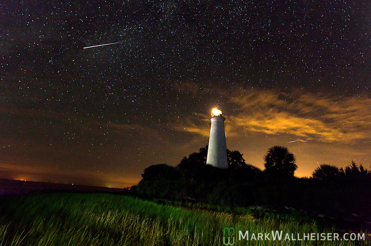 Meteors streak through the sky at the St Marks Lighthouse in the St Marks National Wildlife Refuge in St Marks, Florida during the Perseid Meteor Shower.<br /> <br /> CREDIT: MarkWallheiser.com
