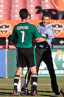 New York Red Bulls head coach Juan Carlos Osorio celebrates a victory with Red Bulls goalkeeper Danny Cepero (1).  New York Red Bulls defeated Houston Dynamo 3-0 for an aggregate  score of 4-1 over Houston Dynamo   at Robertson Stadium in Houston, TX on November 9, 2008 in the second leg of the Western Conference semifinals.  Photo by Wendy Larsen/isiphotos.com