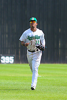 Clinton LumberKings outfielder Ariel Sandoval (15) jogs in from the outfield between innings during a Midwest League game against the Lansing Lugnuts on July 15, 2018 at Ashford University Field in Clinton, Iowa. Clinton defeated Lansing 6-2. (Brad Krause/Four Seam Images)