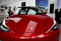 NEW YORK - NEW YORK - MARCH 24: A Tesla car is seen at its local store in Lower Manhattan on March 24, 2021 in New York. Tesla Inc said it bought $1.5 billion worth of bitcoin and would soon accept it as a form of payment for its cars. (Photo by John Smith/VIEWpress)