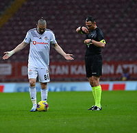 15th March 2020, Istanbul, Turkey;   Caner Erkin of Besiktas argues the yellow card with Referee Abdulkadir Bitigen during the Turkish Super league football match between Galatasaray and Besiktas at Turk Telkom Stadium in Istanbul , Turkey on March 15 , 2020.