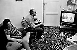 Apartment interior, family at home watching the BBC television news program. Peter Woods the presenter and inset (William) Willie Whitelaw who was the Secretary of State for Northern Ireland. London 1972. 1970s UK