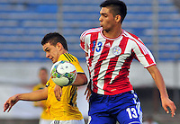 MONTEVIDEO - URUGUAY - 27-01-2015: Rafael Borre (Izq.) jugador de Colombia, disputa el balón Omar Alderete (Der.) de Paraguay, durante partido del Sudamericano Sub 20 entre los seleccionados de Colombia y Paraguay en el estadio Centenario de la ciudad de Montevideo. / Juan Quintero (R) player of Colombia, fights for the ball with Rafael Borre (L) player of Paraguay, during the match for the Sudamericano U 20 between the teams of Colombia and Paraguay in the Centenario stadium in Montevideo city,  Photo: Andres Gomensoro  / Photosport / VizzorImage.