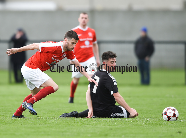 Eoin O Brien of Newmarket Celtic in action against Aaron Nunan of Janesboro during their Munster Junior Cup semi-final at Limerick. Photograph by John Kelly.