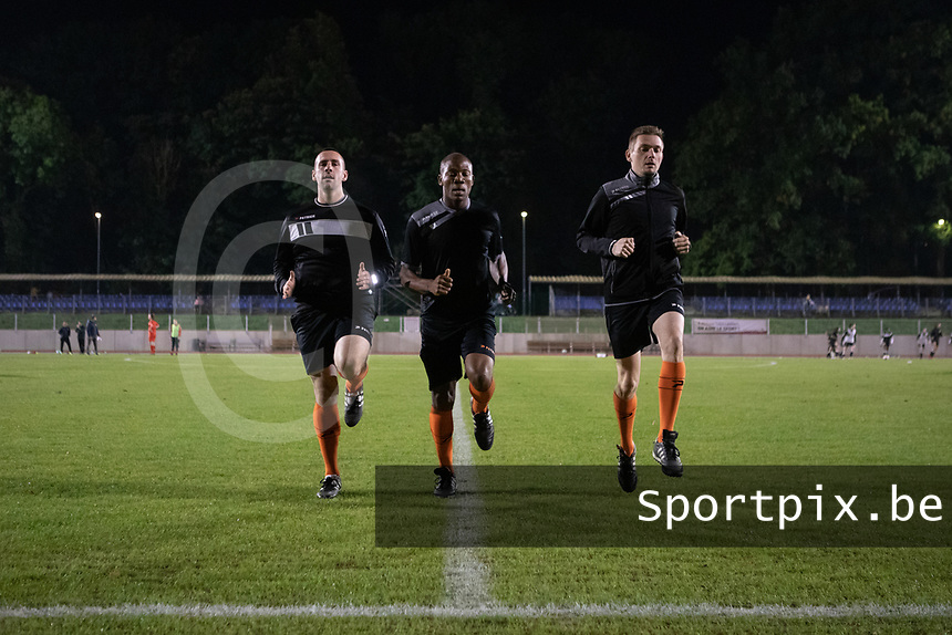 Referee Tanko Frank (M) and assistants Renard Jordan (L) and Cedric Abrassart (R) pictured during a female soccer game between FC Femina White Star Woluwe and Eendracht Aalst on the sixth matchday in the 2021 - 2022 season of Belgian Scooore Womens Super League , friday 8 th of october 2021  in Woluwe , Belgium . PHOTO SPORTPIX   KRISTOF DE MOOR