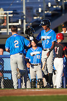 Hudson Valley Renegades Joseph Astacio (7) congratulates Landon Cray (2) after hitting a home run during a game against the Batavia Muckdogs on August 2, 2016 at Dwyer Stadium in Batavia, New York.  Batavia defeated Hudson Valley 2-1.  (Mike Janes/Four Seam Images)
