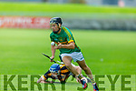 Lixnaw's Shane Conway slips past his Abbeydorney marker in the Senior Hurling Championship quarter final.