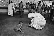 """Mother Teresa in her orphanage spending time with each of them. She takes long hours in the morning to talk and confront them. Mother Teresa (Agnes Gonxha Boyaxihu) the Roman Catholic, Albanian nun revered as India's """"Saint of the Slums,"""" was awarded the 1979 Nobel Peace Prize."""