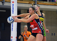Tactix goalshoot Ellie Bird takes a pass under pressure from Kelly Jury during the ANZ Premiership netball match between Central Pulse and Mainland Tactix at Te Rauparaha Arena in Wellington, New Zealand on Friday, 9 July 2021. Photo: Dave Lintott / lintottphoto.co.nz