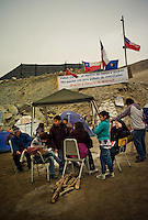 Chile, Copiapo, ago 2010.Relatives of the 33 miners are waiting and prayng for the rescue. Relatives and friends wait outside the mine where 33 miners are trapped in a collapsed tunnel in North Chile since August 5th.