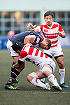 Naoki Ozawa of Japan (R) puts a tackle on Dylan Rogers of Hong Kong (L) during the Asia Rugby Championship 2017 match between Hong Kong and Japan on May 13, 2017 in Hong Kong, China. Photo by Marcio Rodrigo Machado / Power Sport Images
