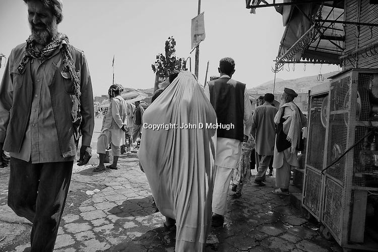 Afghans are seen at Kabul's ancient bird market, 23 August 2012. (John D McHugh