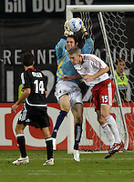 DC United goal keeper Troy Perkins (1) gets possession of the ball while covered by New York Red Bulls John Wolyniec (15). DC United defeated the New York Red Bulls 3-1 at RFK Stadium in Washington DC, Thursday August  22, 2007.