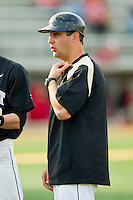 Wake Forest Demon Deacons first base coach T.J. Baxter during the game against the North Carolina State Wolfpack at Wake Forest Baseball Park on March 16, 2013 in Winston-Salem, North Carolina.  The Demon Deacons defeated the Wolfpack 13-4.  (Brian Westerholt/Four Seam Images)