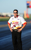 Sept. 23, 2011; Ennis, TX, USA: NHRA crew member for funny car driver Melanie Troxel during qualifying for the Fall Nationals at the Texas Motorplex. Mandatory Credit: Mark J. Rebilas-