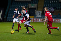 19th December 2020; Dens Park, Dundee, Scotland; Scottish Championship Football, Dundee FC versus Dunfermline; Jordan McGhee of Dundee goes past Iain Wilson and Steven Whittaker of Dunfermline Athletic