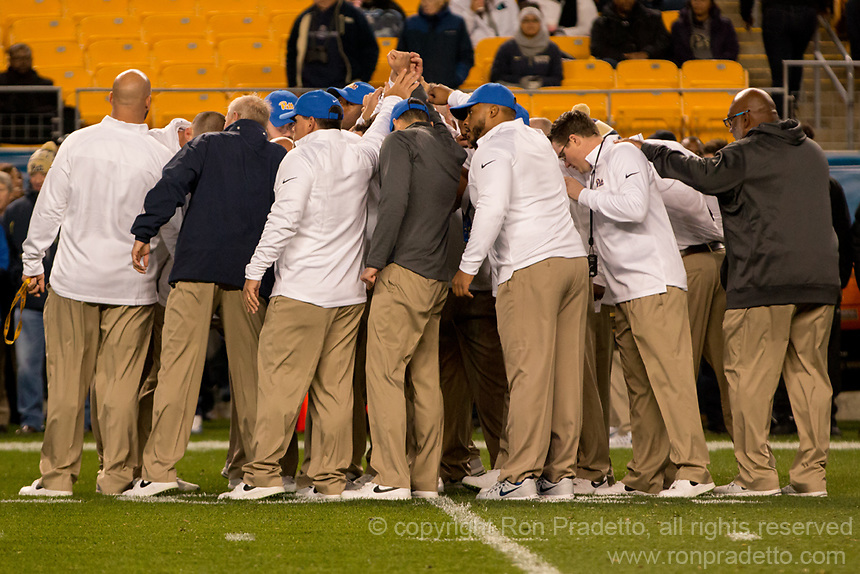 Pitt football coaches huddle before the game. The North Carolina Tarheels defeated the Pitt Panthers football team 34-31 at Heinz Field, Pittsburgh, Pennsylvania on November 9, 2017.