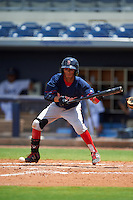 GCL Red Sox shortstop Yomar Valentin (46) lays down a bunt during the second game of a doubleheader against the GCL Rays on August 4, 2015 at Charlotte Sports Park in Port Charlotte, Florida.  GCL Red Sox defeated the GCL Rays 2-1.  (Mike Janes/Four Seam Images)