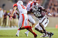 Texas A&M defensive back Devonta Burns (26) attempts to tackle wide receiver Reggie Begelton (9) during NCAA Football game, Saturday, September 06, 2014 in College Station, Tex. Texas A M leads Lamar 31-3 at the halftime. (Mo Khursheed/TFV Media via AP Images)