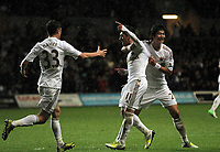 Saturday, 03 November 2012<br /> Pictured: Pablo Hernandez (C) of Swansea celebrating his equaliser against Chelsea with team mates Ki Sung Yueng (R) and Ben Davies (L)<br /> Re: Barclays Premier League, Swansea City FC v Chelsea at the Liberty Stadium, south Wales.