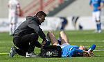 Hamilton Academical St Johnstone....04.04.15<br /> Murray Davidson is treated by physio Michael McBride<br /> Picture by Graeme Hart.<br /> Copyright Perthshire Picture Agency<br /> Tel: 01738 623350  Mobile: 07990 594431