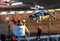 Dec. 10, 2011; Chandler, AZ, USA;  LOORRS pro two unlimited driver Greg Adler takes the checkered flag to win round 15 at Firebird International Raceway. Mandatory Credit: Mark J. Rebilas-