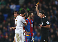 Yohan Cabaye of Crystal Palace is shown a yellow card   during the Barclays Premier League match between Crystal Palace and Swansea  played at Selhurst Park on 28th December 2015 in London