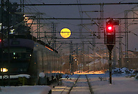 Pictured: The moon rises over Larissa railway station, central Greece.<br /> Re: Heavy snow affects most parts of Greece