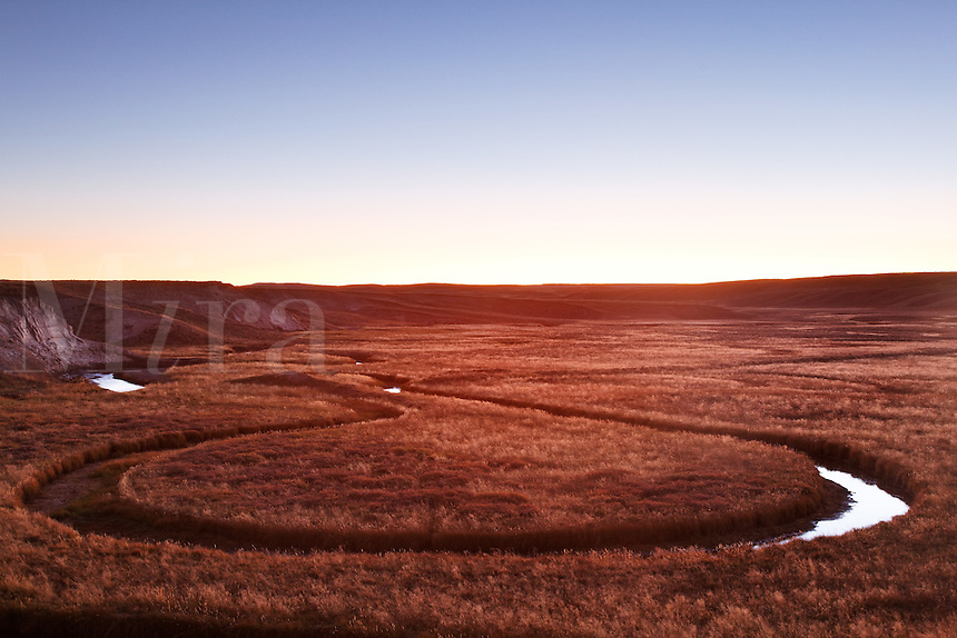 Trout Creek winding through meadows at sunset, Hayden Valley, Yellowstone National Park, Wyoming, USA
