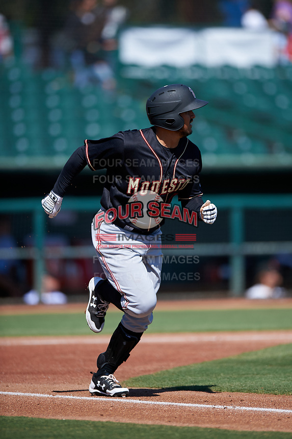 Modesto Nuts first baseman Eugene Helder (10) jogs down the first base line during a California League game against the Inland Empire 66ers on April 10, 2019 at San Manuel Stadium in San Bernardino, California. Inland Empire defeated Modesto 5-4 in 13 innings. (Zachary Lucy/Four Seam Images)