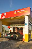 Dubai.  Automatic car wash at filling staton on Sheikh Zayed Road..