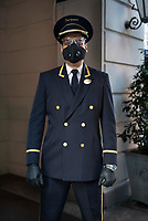 4/6/20-New York City, New York, Coronavirus in New York. Doormen are considered essential workers and suit up for the job to protect against COVID19.  The continue to intercept food deliveries, packages and keep the buildings safe. And do a great Darth Vader impression.