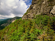 Scenic view of Cannon Mountain from Eagle Pass along Greenleaf Trail in Franconia Notch in the White Mountains New Hampshire on a cloudy day.