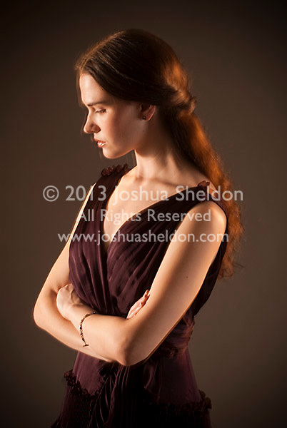 Young woman with eyes closed and arms folded in front of her