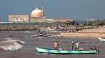 23 November 2011:  Fishermen of Idinthakarai village head for the beach in the shadow of  the Koodankulam Nuclear Power Plant, currently under construction in Tirunelveli district of the southern Indian state of Tamil Nadu.  The voluntary People's Movement Against Nuclear Energy has organised rally's and hunger strikes at the site in an effort to close the facility but have seemingly failed in their on going campaign.  Picture by Graham Crouch/The Australian