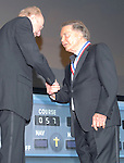 Photo by Mike Ullery/National Aviation Hall of Fame.Academy Award-winning actor and aviation advocate Cliff Robertson is welcomed into the National Aviation Hall of Fame Class of 2006 by aviation legend and fellow enshrinee Bob Hoover during the Hall of Fame's annual enshrinement ceremony in Dayton, Ohio.