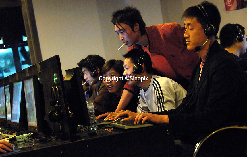 Young people at an Internet cafe in Beijing, China. Chinese authorities have vowed to purge the Internet in China of pornography amid rising disgust over the explicit content in cyberspace..13 Apr 2007