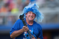A fan competes in an air guitar contest between innings of the Appalachian League game between the Elizabethton Twins and the Danville Braves at American Legion Post 325 Field on July 1, 2017 in Danville, Virginia.  The Twins defeated the Braves 7-4.  (Brian Westerholt/Four Seam Images)