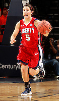 CHARLOTTESVILLE, VA- December 7: Reagan Miller #5 of the Liberty Lady Flames handles the ball during the game against the Virginia Cavaliers on December 7, 2011 at the John Paul Jones arena in Charlottesville, Va. Virginia defeated Liberty 64-38. (Photo by Andrew Shurtleff/Getty Images) *** Local Caption *** Reagan Miller