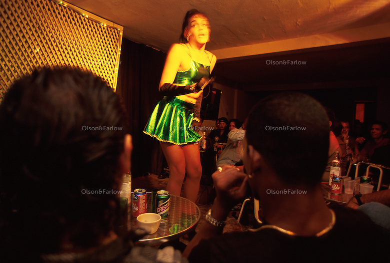 Female impersonators sing and entertain the audience at Castropol nightclub, a cabaret located across from the Malecon in Havana. Attitudes toward gays and lesbians have relaxed in recent years, and the drag queen show attracts a loyal crowd.