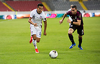 , MEXICO - : Sebastian Saucedo #10 of the United States and Manuel Mayorga #3 of Mexico chase down a ball during a game between  and undefined at  on ,  in , Mexico.