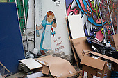 Discarded mural panels at an events company near Old Street roundabout in Shoreditch, London, a run-down commercial district  also known as Silicon Roundabout, which is undergoing gentrification as it becomes a centre for web-based companies and IT start-ups.
