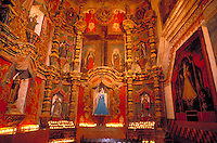Interior view of Virgin Mary side altar at Mission San Xavier del Bac. The present structure was built in 1787-1793 by Franciscan missionaries. Since 1911, it has been maintained as the main church and school of the Tohono O'Odham Indian Reservation on. Tuscon, Arizona